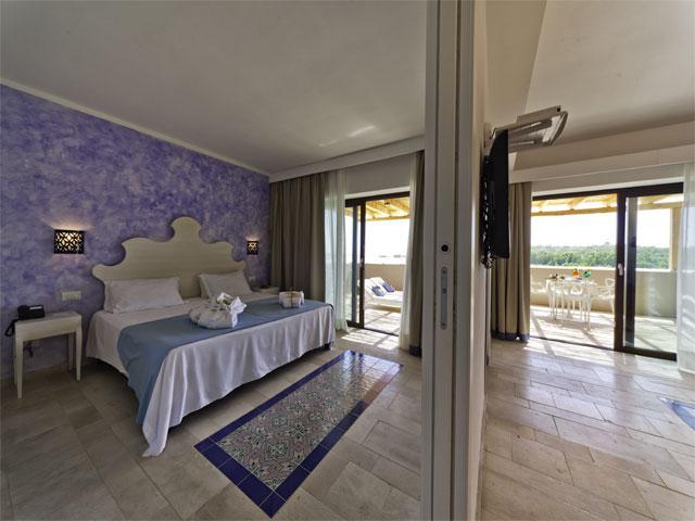 Alle kamers zijn stijlvol ingericht  - Familievakantie Sardinie