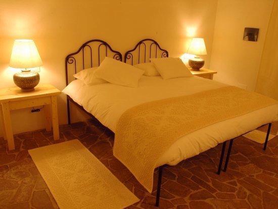 Landelijk ingerichte kamer in Genna e Corte