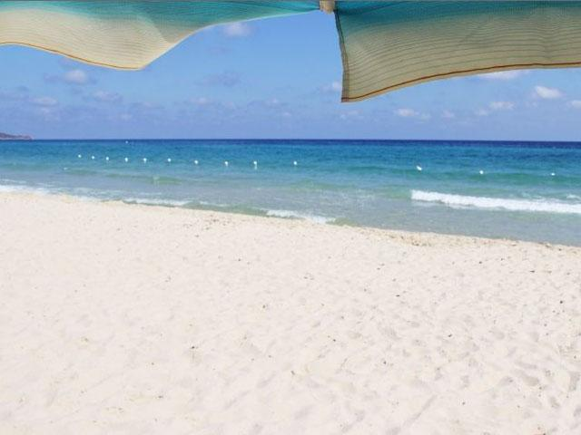 De appartementen van Rey Beach liggen aan het zandstrand van Costa Rei - Zuid Sardinie